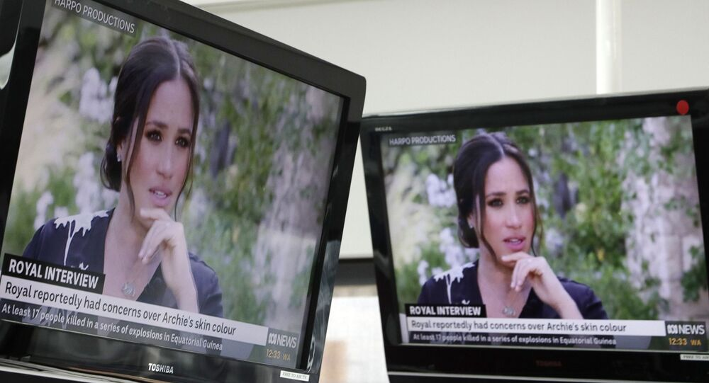 Australian television news in Sydney, Monday, March 8, 2021, reports on an interview of The Duke and Duchess of Sussex by Oprah Winfrey. The interview airs in Australia Monday evening.