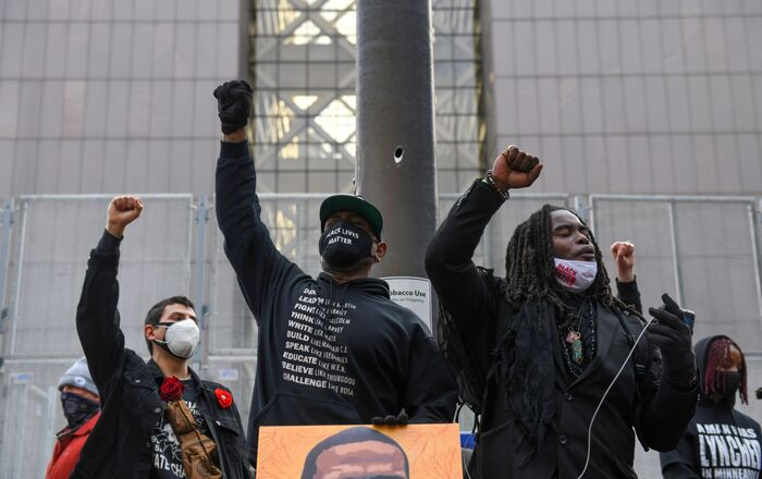 Protesters raise their fists and chant after the I Can't Breathe  Silent March for Justice a day before jury selection is scheduled to begin for the trial of Derek Chauvin, the former Minneapolis policeman accused of killing George Floyd, in Minneapolis, Minnesota, U.S. 7 March 2021