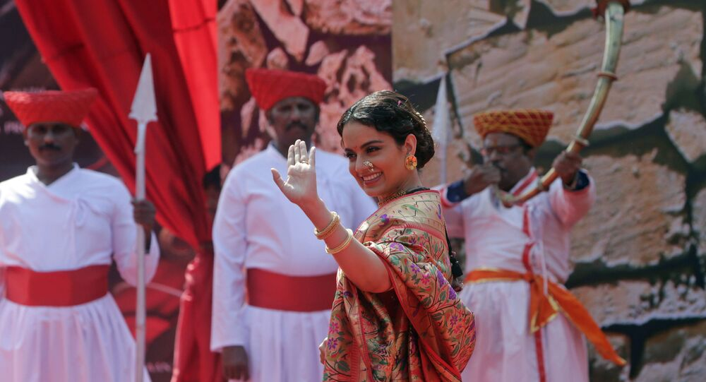 Bollywood actress Kangana Ranaut waves to the gathering during the trailer launch of her movie Manikarnika- The Queen of Jhansi in Mumbai, India, Tuesday, Dec.18, 2018.