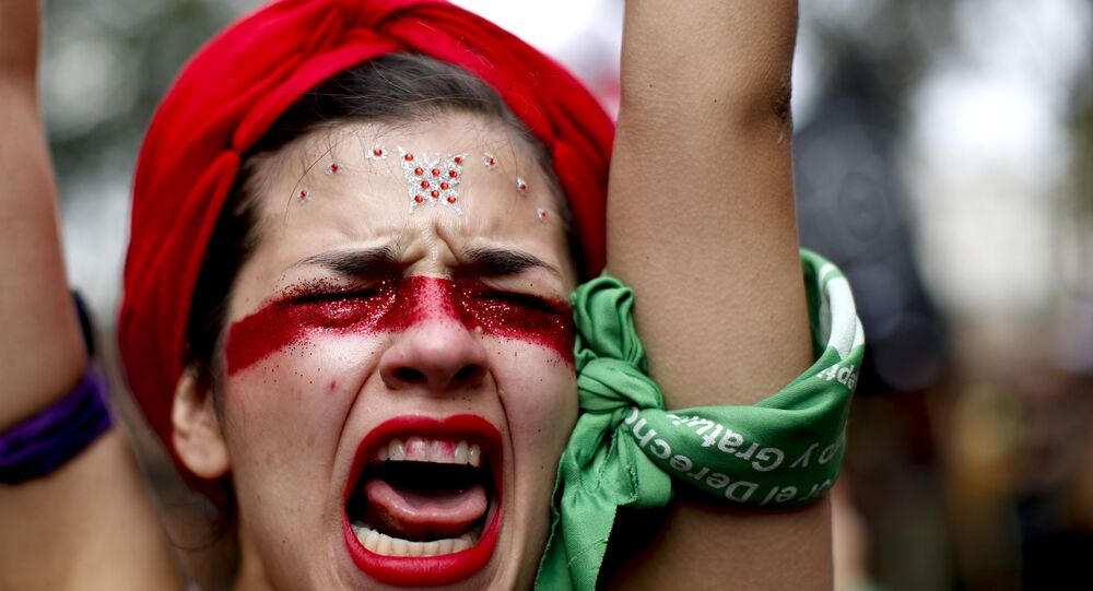 A woman shouts slogans as she marches to Congress to commemorate International Women's Day in Buenos Aires, Argentina, Monday, March 9, 2020.