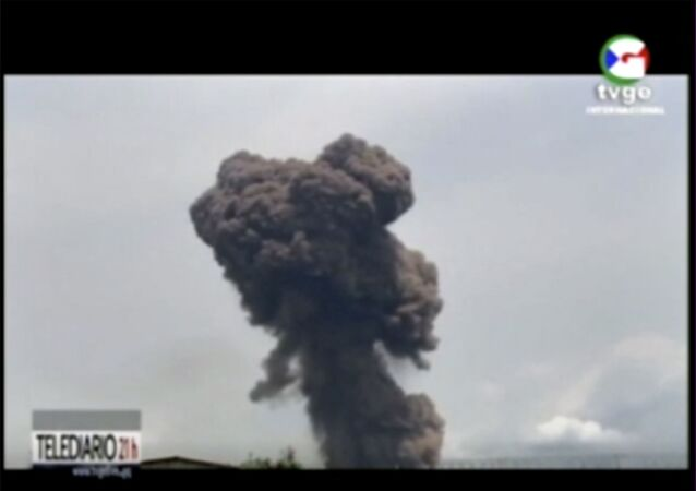 This TVGE image made from video shows smoke rising over the blast site at a military barracks in Bata, Equatorial Guinea, Sunday, March 7, 2021. A series of explosions killed at least 20 people and wounded more than 600 others on Sund