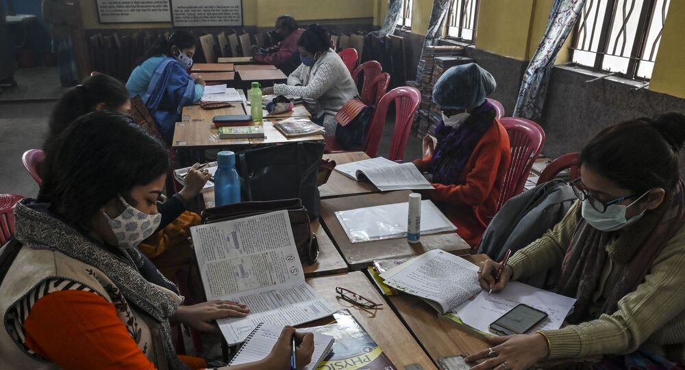 Teachers attend online classes with their mobile phones as sanitization work is in progress  prior to its reopening for higher classes after the spread of the Covid-19 coronavirus, at a private school in Kolkata on February 3, 2021.