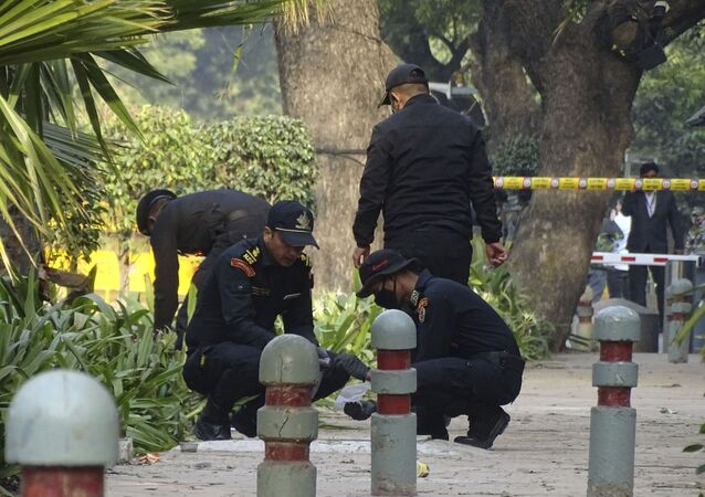 National Security Guard soldiers inspect the site of a blast near the Israeli Embassy in New Delhi, India, Saturday, Jan. 30, 2021.