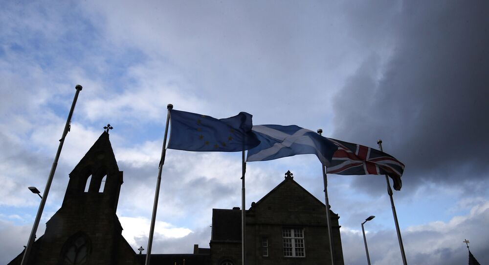 European, Scottish and Great Britain flags float in front of the Scottish Parliament in Edinburgh, Scotland, Wednesday, Sept 4, 2019. The Scottish court says British Prime Minister Boris Johnson's planned suspension of Parliament is lawful. The closely watched decision was revealed Wednesday. It is the first of several challenges to Johnson's maneuver that gives lawmakers little time to prevent Britain from crashing out of the European Union without an agreement on Oct. 31.