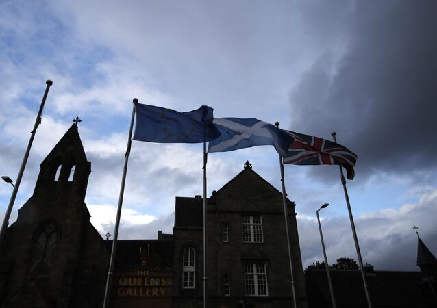 European, Scottish and Great Britain flags float in front of the Scottish Parliament in Edinburgh, Scotland, Wednesday, 4 September 2019.