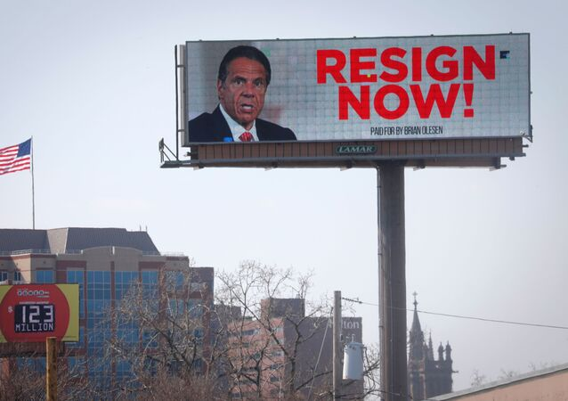 Electronic billboard displays message for New York Governor Cuomo to Resign Now in Albany