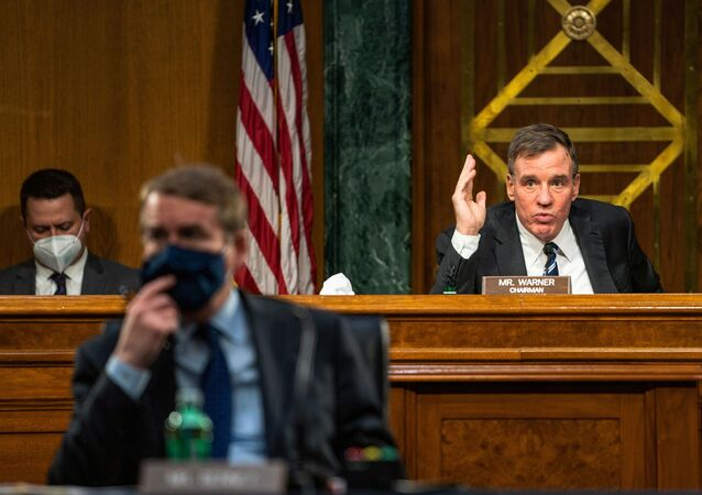 Committee chairman Sen. Mark Warner (D-VA) gives an opening statement during the Senate Intelligence Committee hearing on Capitol Hill in Washington, U.S., February 23, 2021.