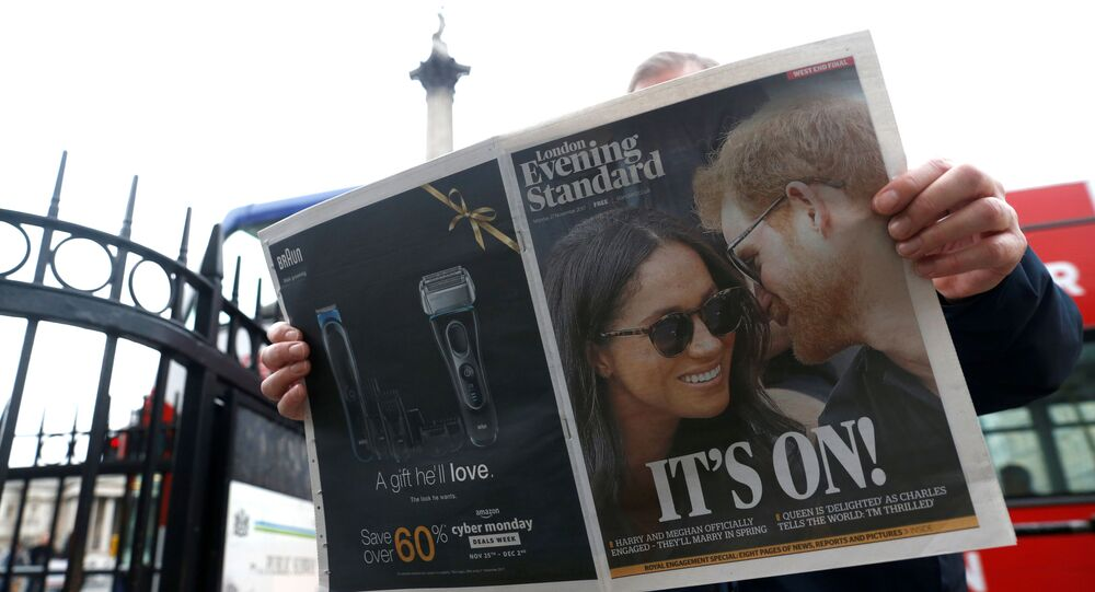 A person is seen reading the London Evening Standard with the news that Prince Harry has announced his engagement to Meghan Markle, London, Britain, 27 November 2017. REUTERS/Darrin Zammit Lupi/File Photo
