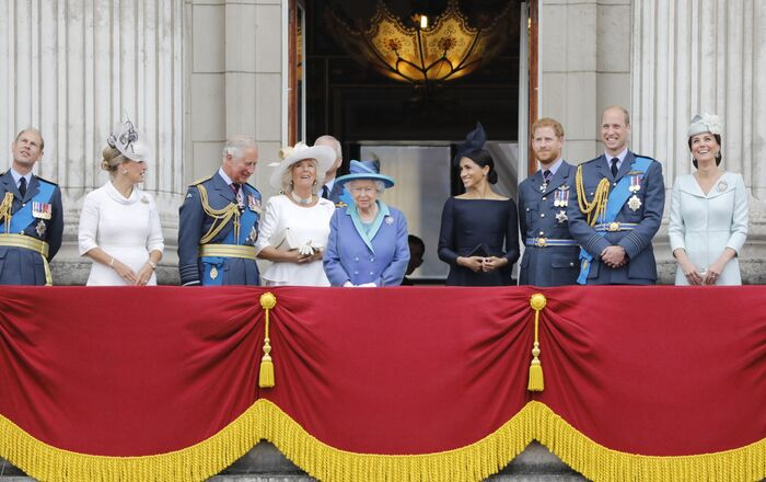 (L-R) Britain's Prince Edward, Earl of Wessex, Britain's Sophie, Countess of Wessex, Britain's Prince Charles, Prince of Wales, Britain's Camilla, Duchess of Cornwall, Britain's Queen Elizabeth II, Britain's Meghan, Duchess of Sussex, Britain's Prince Harry, Duke of Sussex, Britain's Prince William, Duke of Cambridge and Britain's Catherine, Duchess of Cambridge stand on the balcony of Buckingham Palace on July 10, 2018 to watch a military fly-past to mark the centenary of the Royal Air Force (RAF).
