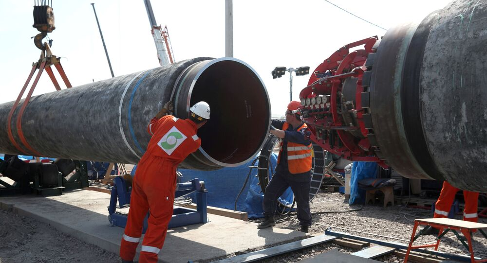 FILE PHOTO: FILE PHOTO: Workers are seen at the construction site of the Nord Stream 2 gas pipeline, near the town of Kingisepp, Leningrad region, Russia, June 5, 2019