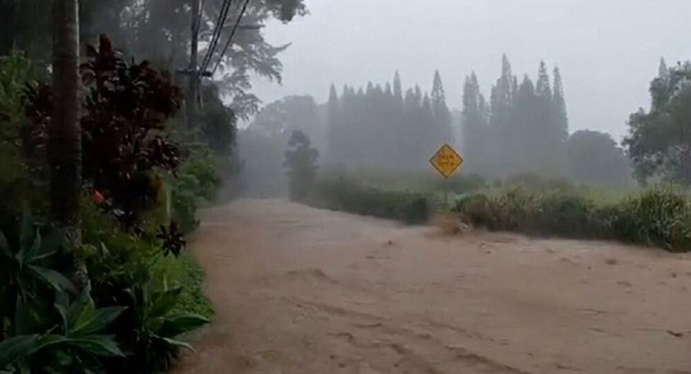 A flooded road is seen near the breached Kaupakalua dam, in Haiku on Maui, Hawaii, U.S. March 8, 2021 in this still image from social media video