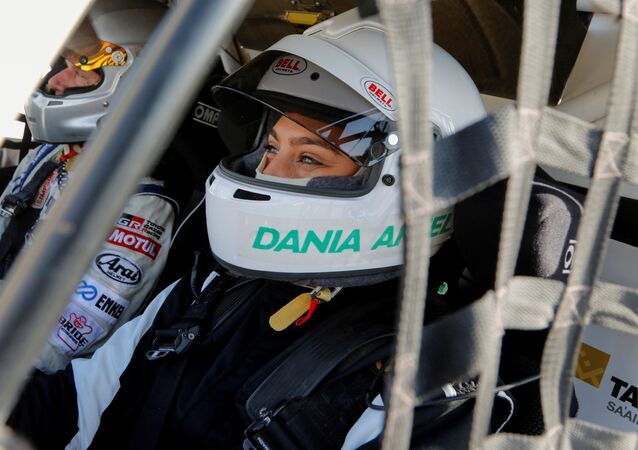 A Saudi female rally driver, Dania Akeel, sits in her T1-Buggy during the first stage of the Sharqiyah International Baja 2021 Rally, in Dhahran, Saudi Arabia, 4 March 2021.