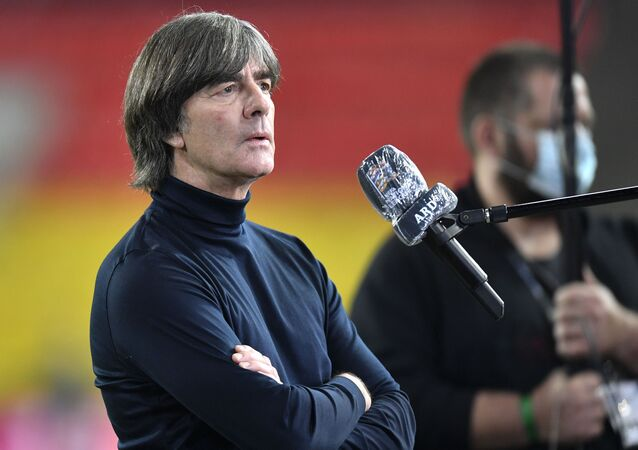 FILE - In this Tuesday, Oct. 13, 2020 file photo, Germany's head coach Joachim Loew is interviewed ahead of the UEFA Nations League soccer match between Germany and Switzerland in Cologne, Germany. Loew on Tuesday, Nov.