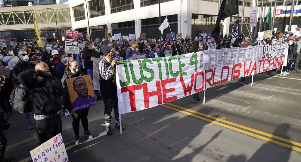 Demonstrators gather in Minneapolis as a jury is selected for the trial of a police officer accused of killing George Floyd.