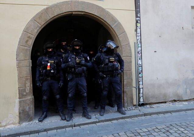 Riot police officers wait during a protest against the Czech government's restrictions at the Old Town Square, as the spread of the coronavirus disease (COVID-19) continues in Prague, Czech Republic, March 7, 2021