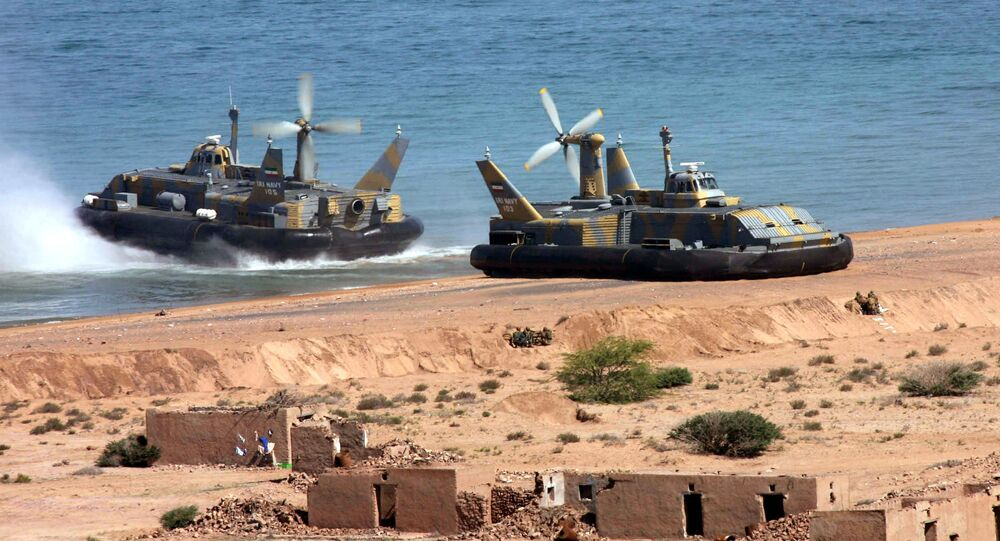 Two hovercraft of Iran's elite Revolutionary Guard come ashore, as they take part in manoeuvres in the Gulf and Sea of Oman, Wednesday, 5 April 2006. The Revolutionary Guard, the elite branch of Iran's military, have been holding manoeuvres - code-named Great Prophet - since 31 March, touting what they call domestically built technological advances in their armed forces. (AP Photo/Mehr News, Sajjad Safari)