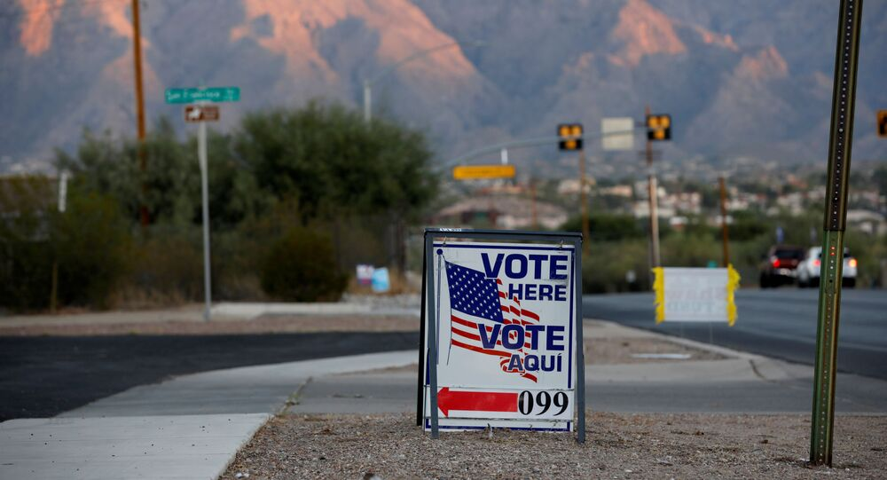 Sign directs voters to a polling station on Election Day in Tucson, Arizona, U.S. November 3, 2020.