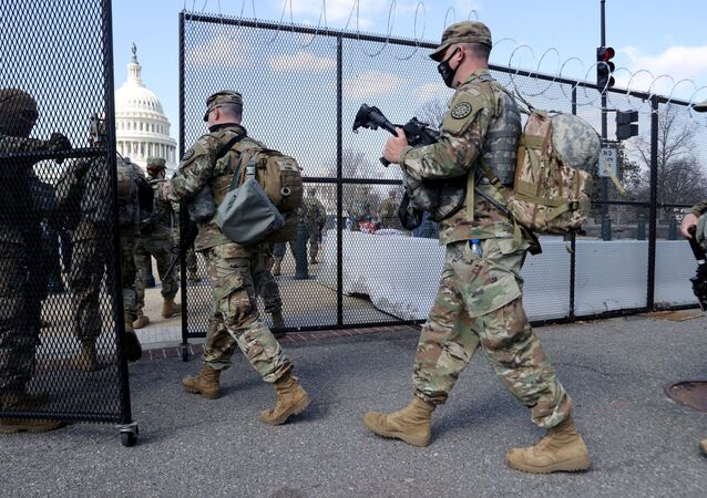 FILE PHOTO: National Guard soldiers patrol the grounds of the U.S. Capitol after police warned that a militia group might try to attack the Capitol complex in Washington, U.S. March 4, 2021. REUTERS/Jonathan Ernst/File Photo