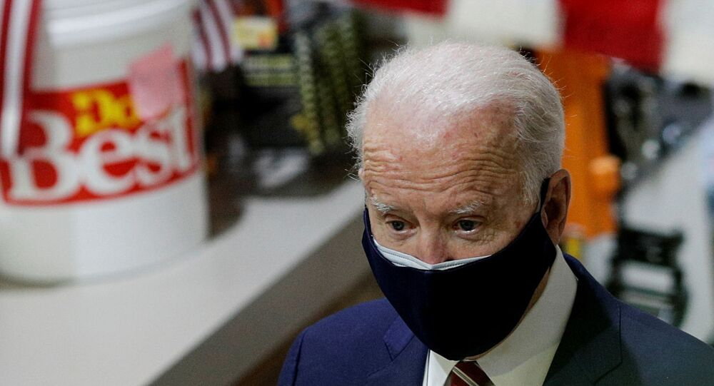 U.S. President Joe Biden walks through W.S. Jenks & Son hardware store as he visits the small business that has benefited from the Paycheck Protection Program, which provides forgivable loans to businesses negatively impacted by the coronavirus disease (COVID-19) pandemic, in Washington, U.S., March 9, 2021