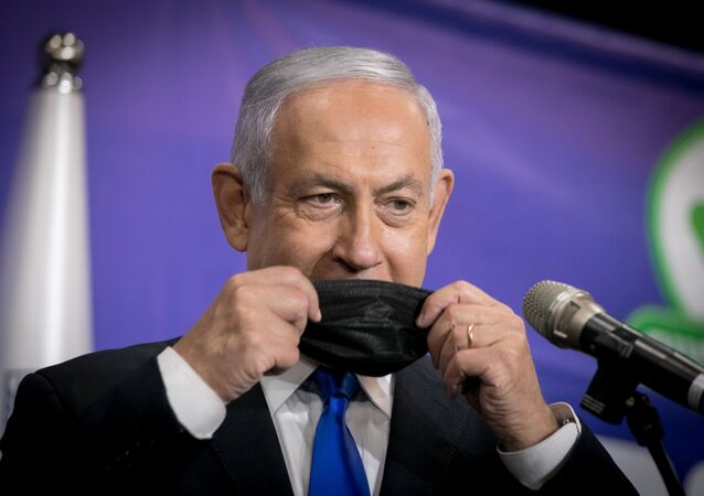 Israeli Prime Minister Benjamin Netanyahu adjusts his mask during a news conference after his meeting with the Israeli citizen no. 5,000,000 to get the Pfizer-BioNTech coronavirus disease (COVID-19) vaccine, in Tel Aviv, Israel, March 8, 2021