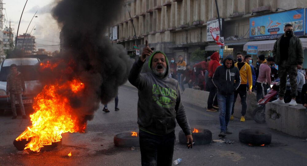 A demonstrator gestures during a protest against the fall in Lebanese pound currency and mounting economic hardships, in Sidon, Lebanon March 8, 2021