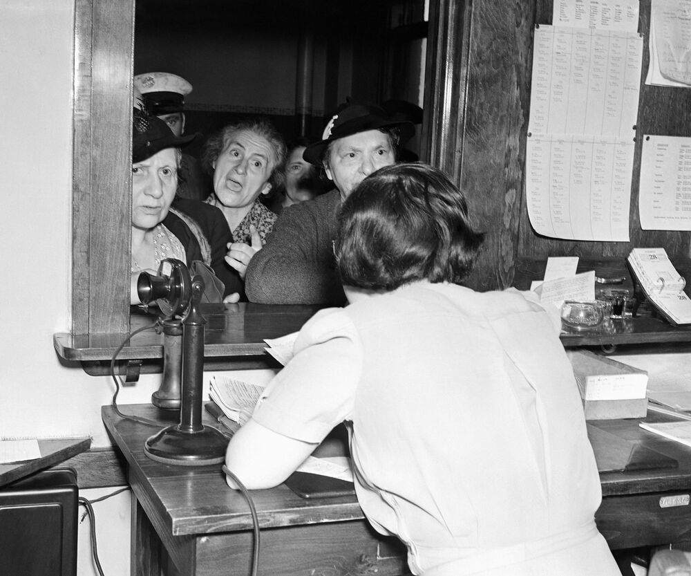 Several of the hundreds of relief clients who demanded food at the Cleveland City Relief Station in London on 6 May 1938 as the city felt another of its poor aid crises.