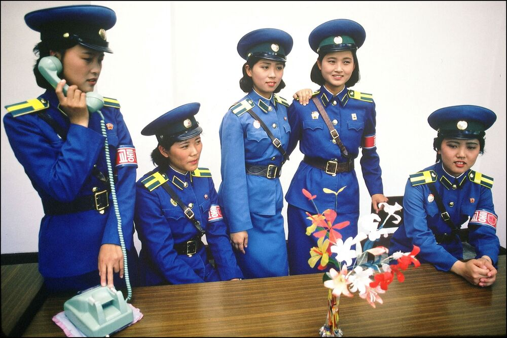Young policewomen in charge of welcoming foreign visitors pose at a police station in central Pyongyang in October 1991.