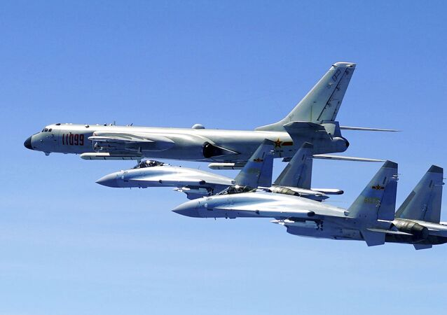 In this photo released by Xinhua News Agency and taken Friday, May 11, 2018, two Su-35 fighter jets and a H-6K bomber from the People's Liberation Army air force fly in formation during patrol that included the Luzon Straits also known as Bashi Straits near Taiwan