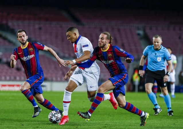 PSG's Kylian Mbappe, center, fights for the ball with Barcelona's Oscar Mingueza during the Champions League round of 16, first leg soccer match between FC Barcelona and Paris Saint-Germain at the Camp Nou stadium in Barcelona, Spain, Tuesday, Feb. 16, 2021