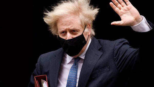 Britain's Prime Minister Boris Johnson gestures outside Downing Street in London, Britain, March 10, 2021 - Sputnik International