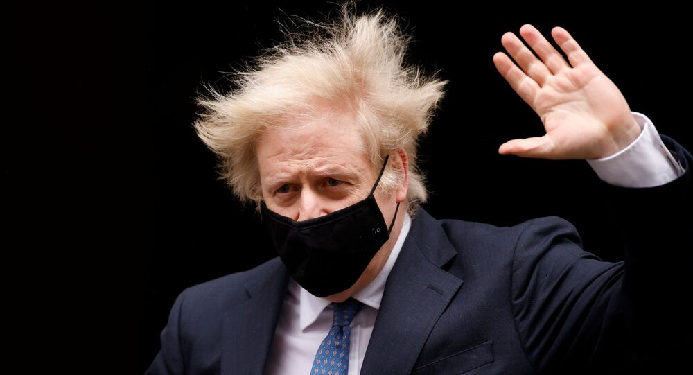 Britain's Prime Minister Boris Johnson gestures outside Downing Street in London, Britain, March 10, 2021