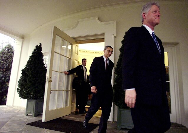 Former US President Bill Clinton (R), with his Chief of Staff John Podesta (C) and his aid Doug Band (L), leaves the Oval Office of the White House for the last time 20 January, 2001, in Washington