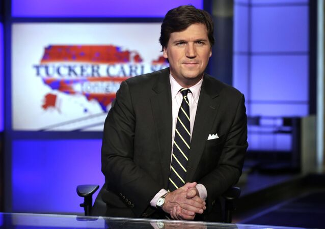 FILE - In this March 2, 2017 file photo, Tucker Carlson, host of Tucker Carlson Tonight, poses for photos in a Fox News Channel studio, in New York. Carlson, who on Monday's show addressed the story of his former top writer, Blake Neff, who resigned after CNN found he had written a series of controversial tweets under a pseudonym, has left for vacation. It fits a pattern at Fox, whose personalities tend to go away to cool off when the heat is on. Carlson's vacation is the sixth example in a little more than three years. A Fox representative confirmed Carlson's vacation was planned before the Neff story broke. (AP Photo/Richard Drew, File)
