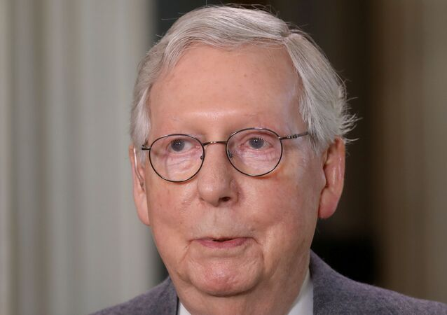FILE PHOTO: U.S. Senate Minority Leader Mitch McConnell (R-KY) stops for a television interview on Capitol Hill in Washington, U.S., March 3, 2021. REUTERS/Leah Millis/File Photo