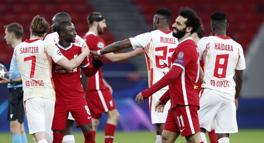 Soccer Football - Champions League - Round of 16 Second Leg - Liverpool v RB Leipzig - Puskas Arena, Budapest, Hungary - March 10, 2021 Liverpool's Mohamed Salah celebrates with teammates after the match