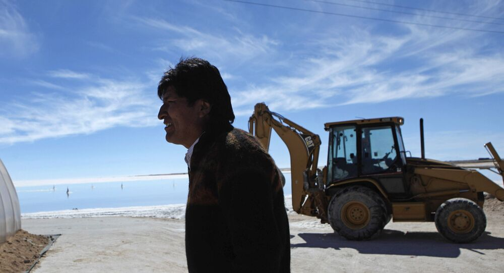 Bolivia's President Evo Morales tours a semi-industrial plant to produce potassium chloride, used to manufacture batteries based on lithium, after its opening ceremony at the Uyuni salt desert, outskirts of Llipi, Bolivia, Thursday, Aug. 9, 2012. The salt flats of Uyuni have triggered international interest among energy companies due to its lithium reserves.