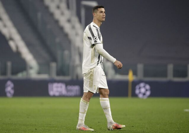 Juventus' Cristiano Ronaldo walks on the pitch at the end of the Champions League, round of 16, second leg, soccer match between Juventus and Porto in Turin, Italy, Tuesday, 9 March 2021. Juventus won 3-2 but Porto advances on a 4-4 aggregate result.