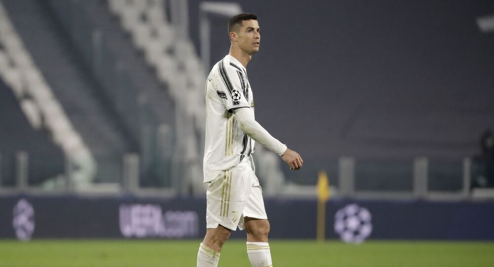 Juventus' Cristiano Ronaldo on the pitch at the end of the second leg of the 16th round of the Champions League match between Juventus and Porto in Turin, Italy, on Tuesday 9 March 2021. Juventus won 3-2 but Porto advances on a 4-4 aggregate result.