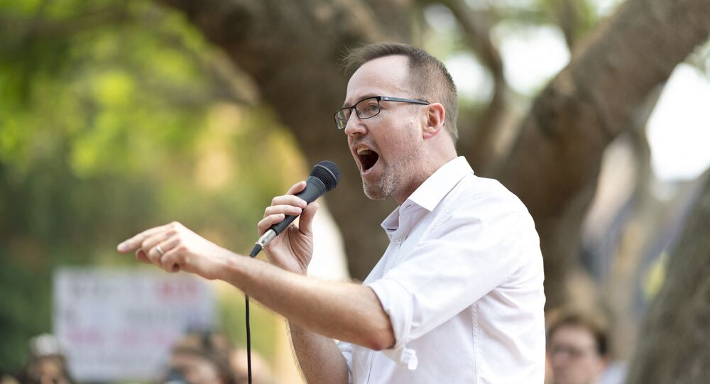 New South Wales Legislative Council member David Shoebridge speaks during a climate protest rally in Sydney on December 21, 2019