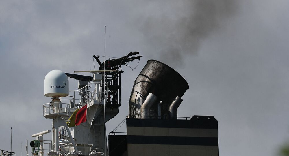 Smoke is seen pouring from the smoke stack on a container ship at Port Everglades on November 05, 2019 in Fort Lauderdale, Florida.