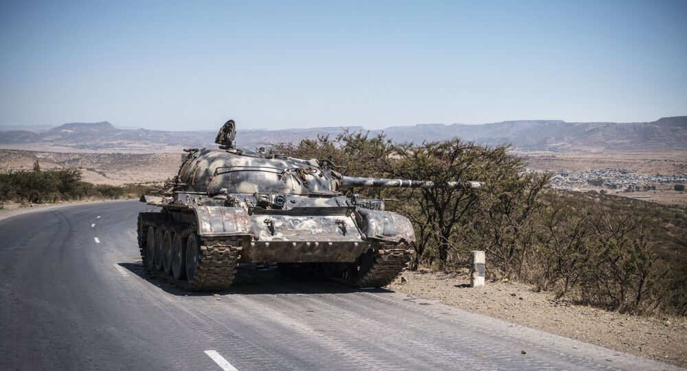A damaged Ethiopian tank sits by the roadside in Tigray, close to the border with Sudan