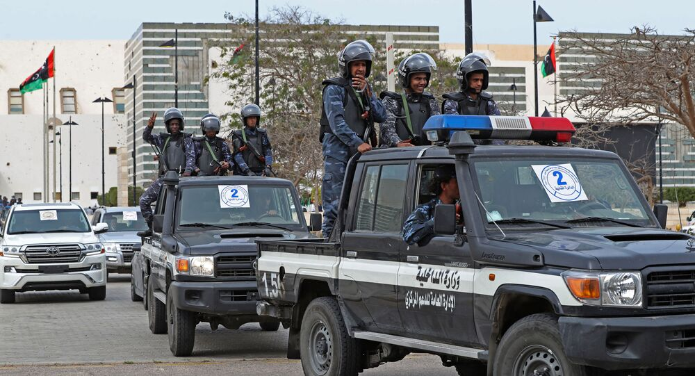 Libyan security forces keep watch outside Ouagadougou Conference Centre in the north-central city of Sirte on March 10, 2021 during a parliament session.