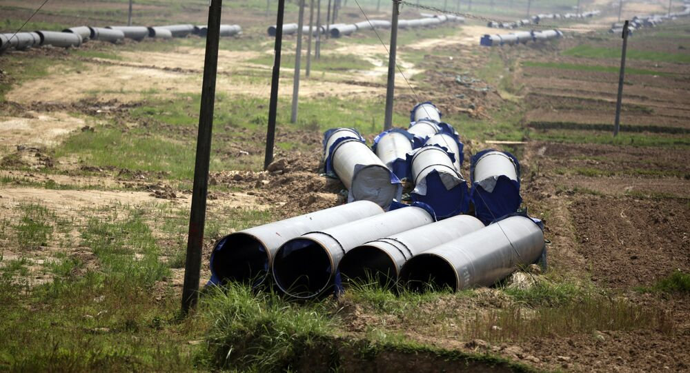 In this May 25, 2012 photo, the pipes for a 770 kilometer (480 mile) pipeline that eventually will carry Middle East gas and oil shipped through the Indian Ocean to thirsty Chinese industries further to the east are placed in fields near Ruili, near Myanmar border,Yunnan Province, China.