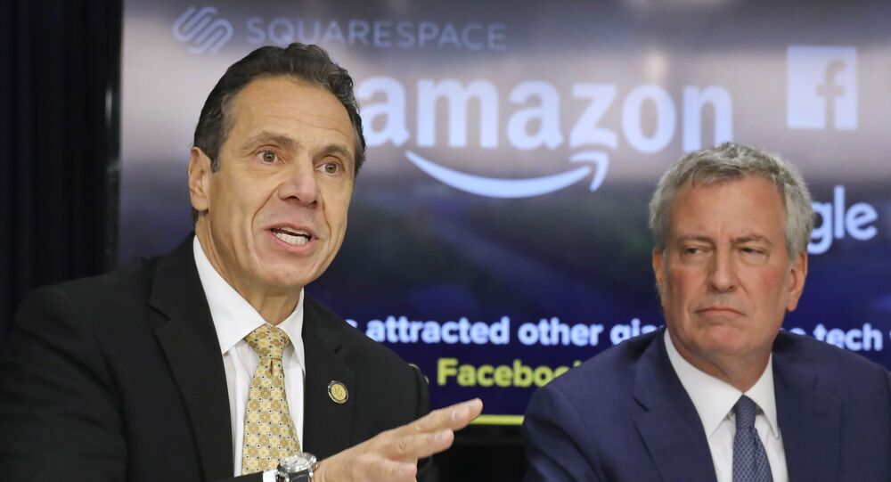 New York Gov. Andrew Cuomo, left, and New York City Mayor Bill de Blasio hold a news conference Tuesday Nov. 13, 2018, in New York. Amazon said it will split its much-anticipated second headquarters between New York and northern Virginia. Its New York location will be in the Long Island City neighborhood of Queens. (AP Photo/Bebeto Matthews)