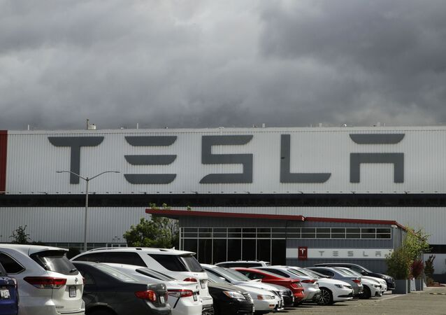 This 12 May 2020 file photo photo shows the Tesla plant in Fremont, California. Tesla is looking to raise up to $5 billion in capital through a stock offering as the electrical vehicle and solar panel-maker seeks to take advantage of strong demand for its products.