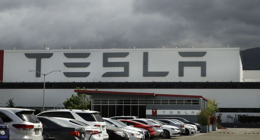 This May 12, 2020 file photo photo shows the Tesla plant in Fremont, Calif. Tesla is looking to raise up to $5 billion in capital through a stock offering as the electrical vehicle and solar panel maker seeks to take advantage of strong demand for its products.
