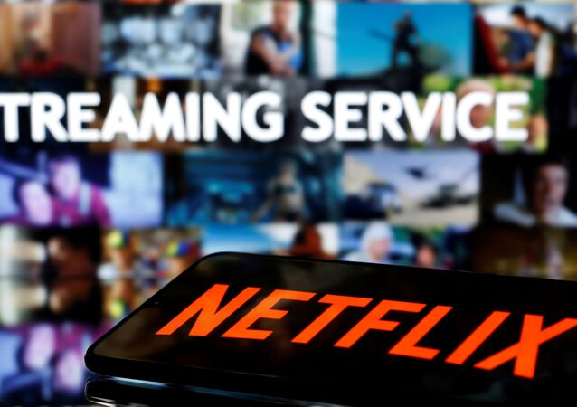 FILE PHOTO: A smartphone with the Netflix logo lies in front of displayed Streaming service words in this illustration taken March 24, 2020