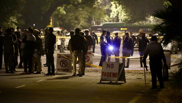Policemen stand guard near the Israeli Embassy after a blast in the area in New Delhi, India, Friday, Jan. 29, 2021 - Sputnik International