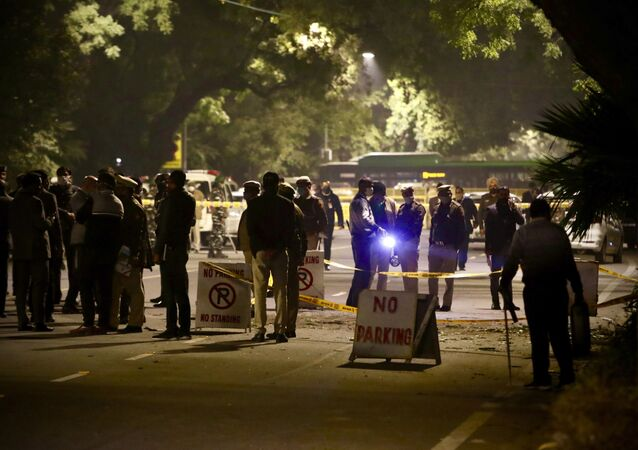 Policemen stand guard near the Israeli Embassy after a blast in the area in New Delhi, India, Friday, Jan. 29, 2021
