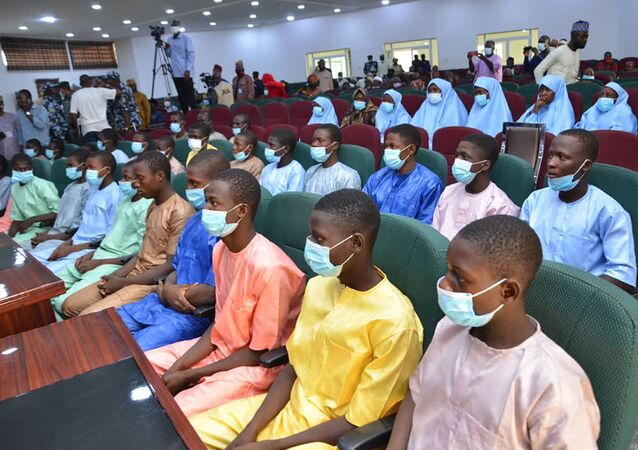 Abducted students of Government Science College Kagara sit in the state conference hall after being freed in Minna, Niger State, central Nigeria, on February 27, 2021.